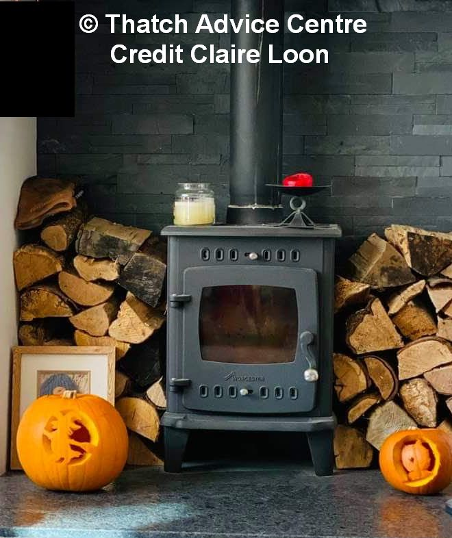How not to stack logs around a working woodburner -