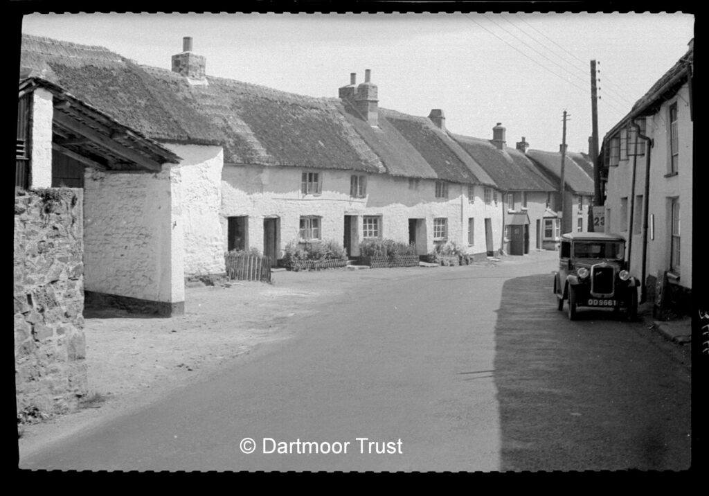 Dartmoor Trust - old A30 in Sticklepath in 1934 - they are still thatched